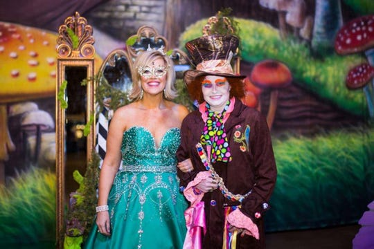 The queen and the Mad Hatter, who served as mistress of ceremony.