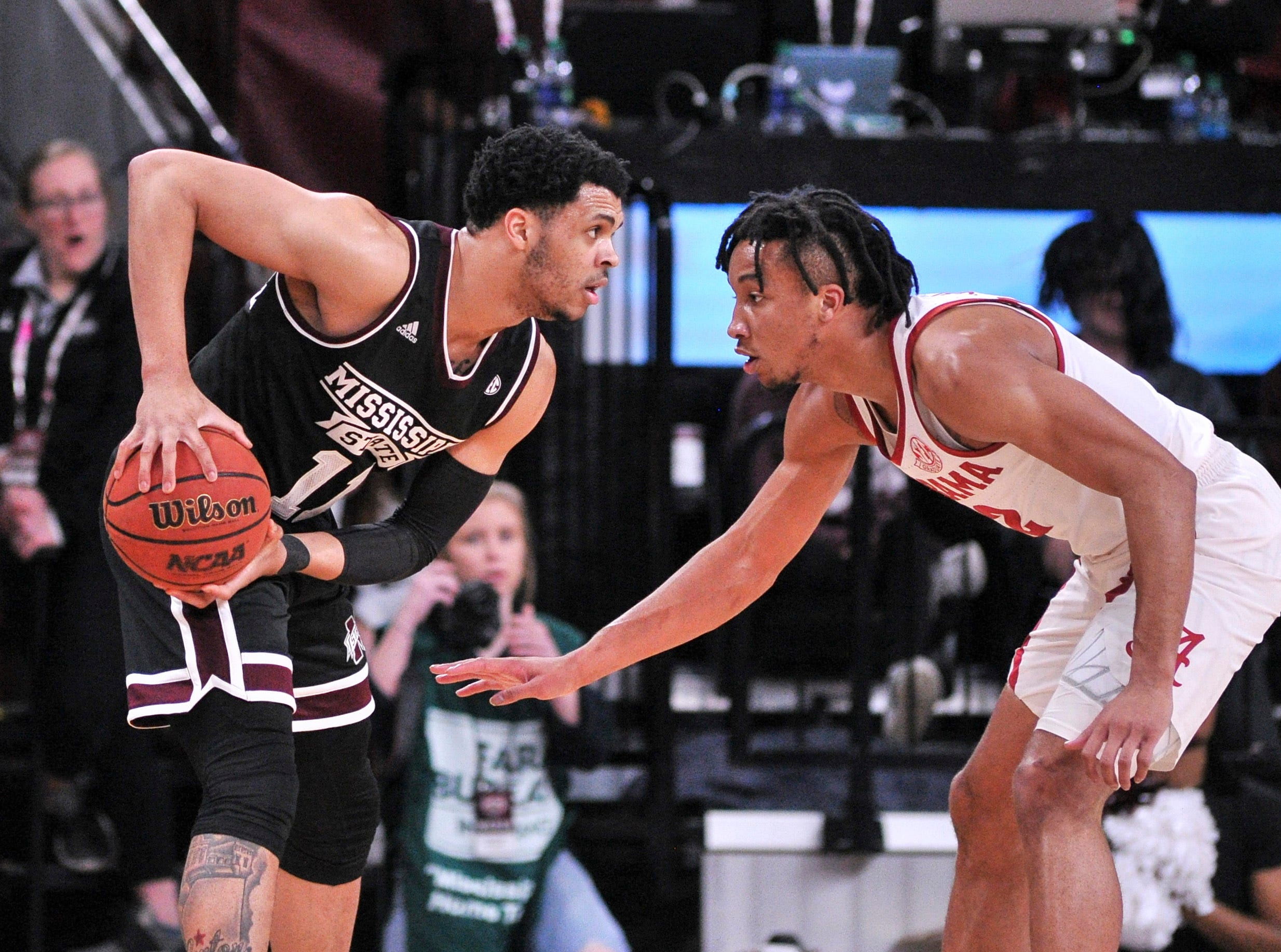Feb 12, 2019; Starkville, MS, USA; Mississippi State Bulldogs guard Quinndary Weatherspoon (11) handles the ball against Alabama Crimson Tide guard Dazon Ingram (12) during the second half at Humphrey Coliseum. Mandatory Credit: Justin Ford-USA TODAY Sports