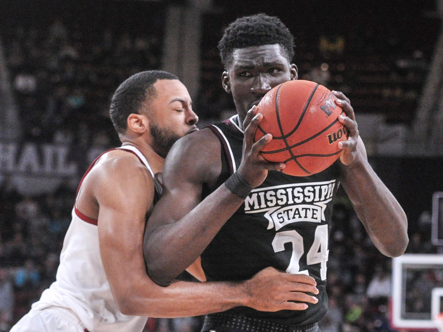 Feb 12, 2019; Starkville, MS, USA; Mississippi State Bulldogs forward Abdul Ado (24) goes to the basket against Alabama Crimson Tide forward Galin Smith (30) during the first half at Humphrey Coliseum. Mandatory Credit: Justin Ford-USA TODAY Sports