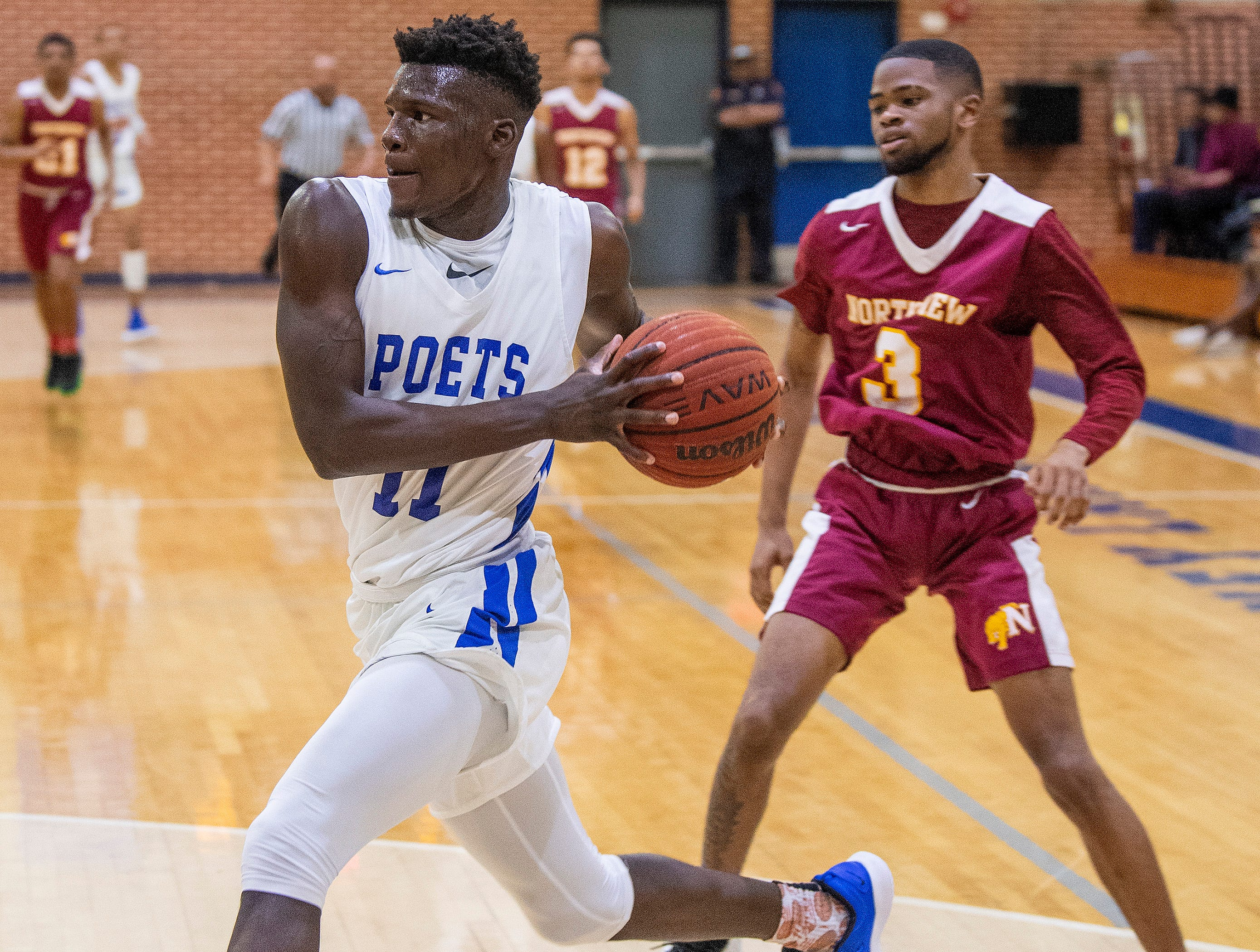 Lanier's Antwan Burnett (11) against Northview at the Lanier campus in Montgomery, Ala., on Tuesday February 12, 2019.