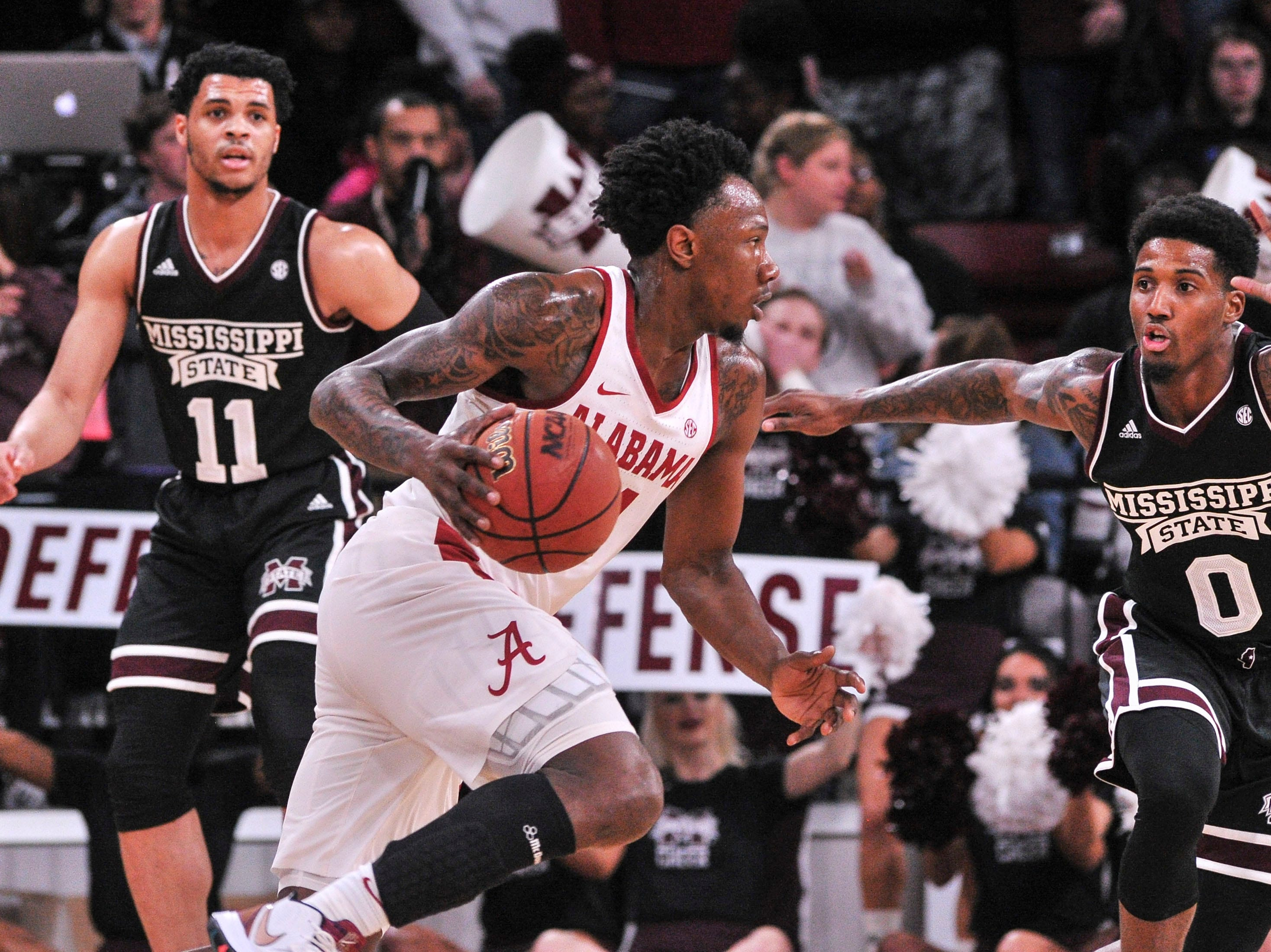 Feb 12, 2019; Starkville, MS, USA; Alabama Crimson Tide guard Tevin Mack (34) dribbles the ball past Mississippi State Bulldogs guard Nick Weatherspoon (0) during the first half at Humphrey Coliseum. Mandatory Credit: Justin Ford-USA TODAY Sports