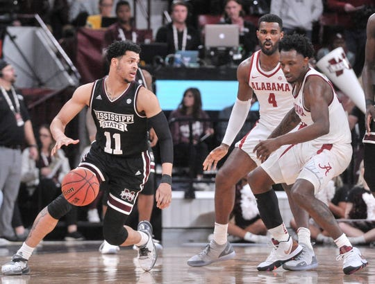 Feb 12, 2019; Starkville, MS, USA; Mississippi State Bulldogs guard Quinndary Weatherspoon (11) dribbles the ball as Alabama Crimson Tide guard Tevin Mack (34) defends during the second half at Humphrey Coliseum. Mandatory Credit: Justin Ford-USA TODAY Sports