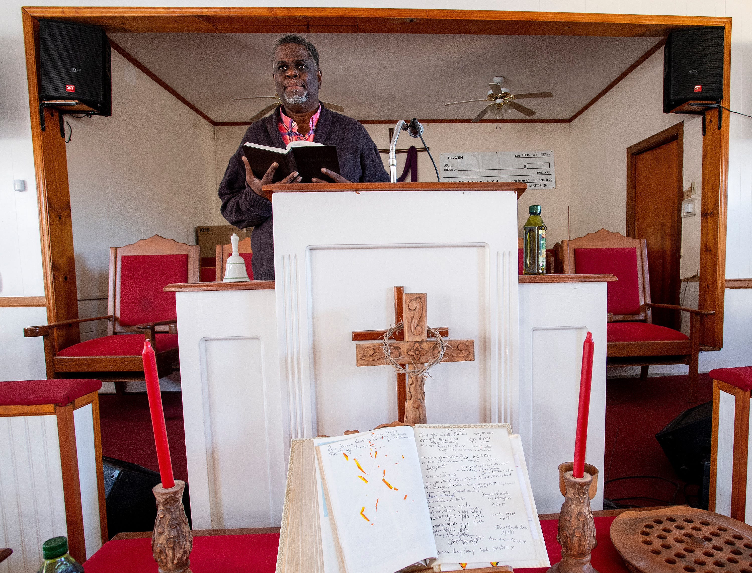 Ken Austin, executive director of the Mercy House and pastor at New Walk of Life Church, stands in the pulpit at his church in Montgomery, Ala., on Wednesday February 13, 2019.