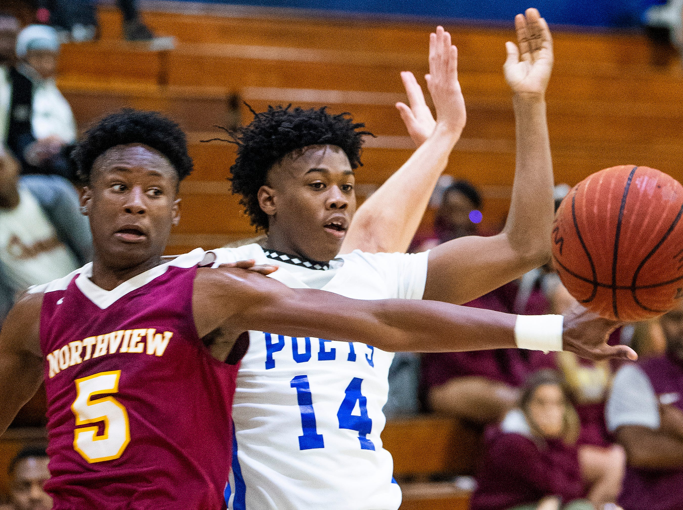 Lanier's Elijah White (14) and Northview's Christopher Shakleford (5) go after the ball at the Lanier campus in Montgomery, Ala., on Tuesday February 12, 2019.