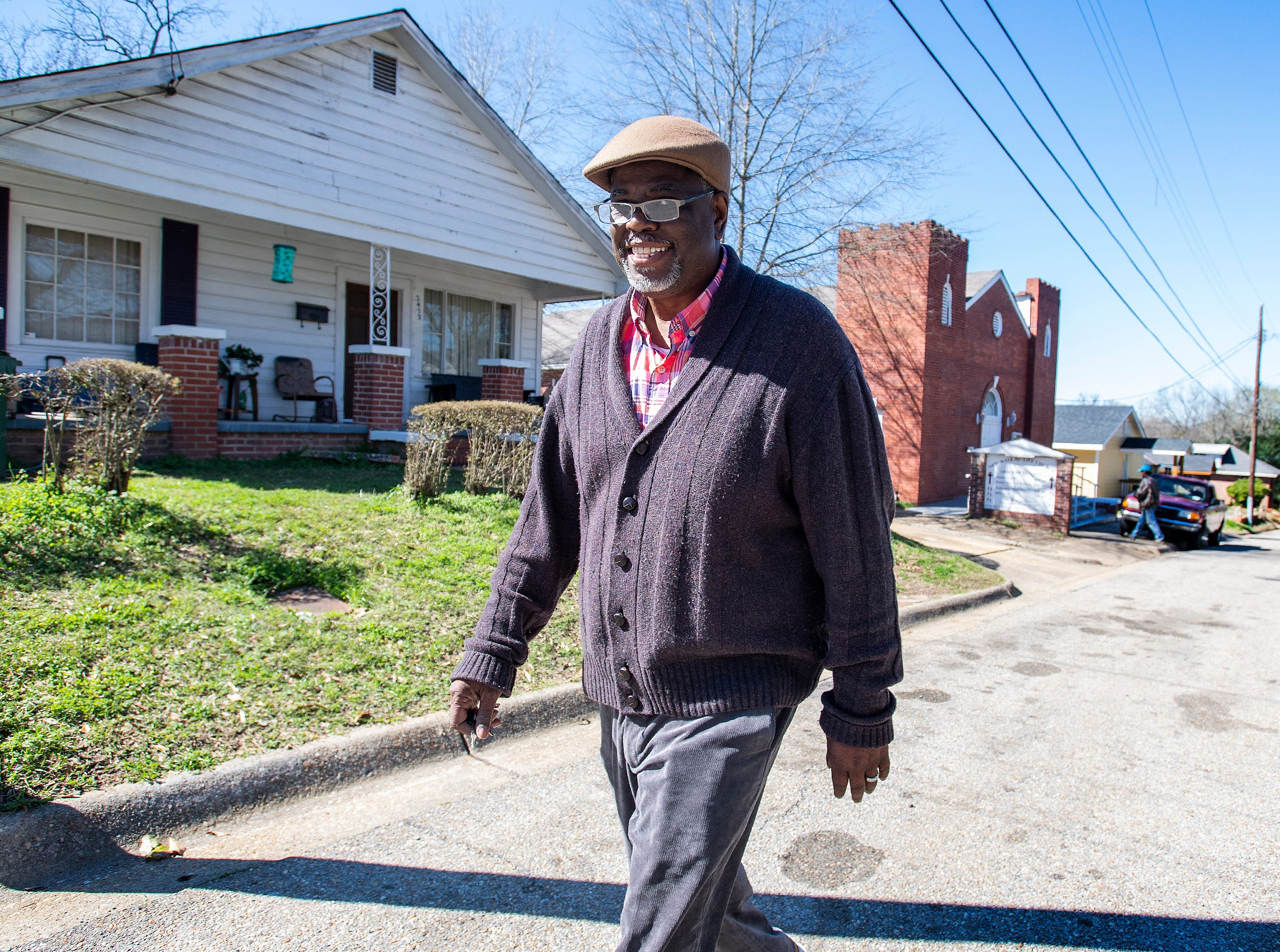 Ken Austin, executive director of the Mercy House and pastor at New Walk of Life Church, walks between his church and Mercy House in Montgomery, Ala., on Wednesday February 13, 2019.