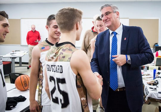 Blackford guard Luke Brown (25) meets Indiana governor Eric Holcomb before the Bruins played Daleville at Blackford High School Tuesday, Feb. 12, 2019.