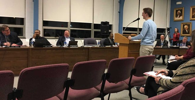 Muncie Central High School student George Schafer addresses the school board on Tuesday night.