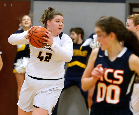Providence Christian's Sydney Gibson (42) looks to pass during a game against Nashville Christian on Tuesday.