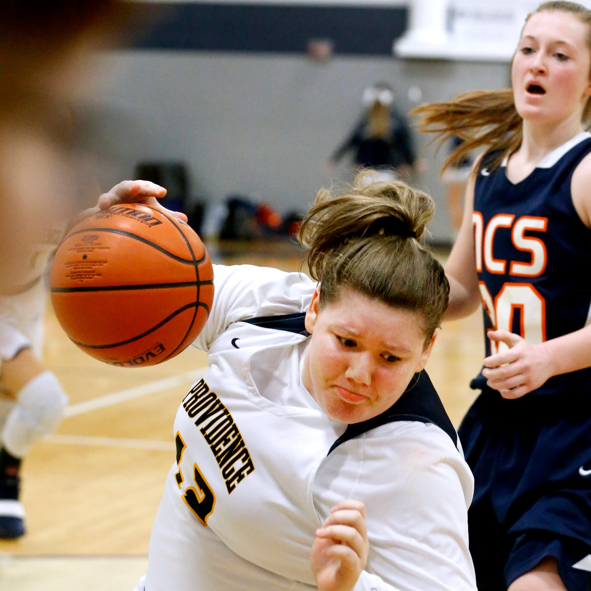 PCA's Sydney Gibson (42) goes up for a shot as she starts to fall during the game against NCS on Tuesday, Feb. 12, 2019.