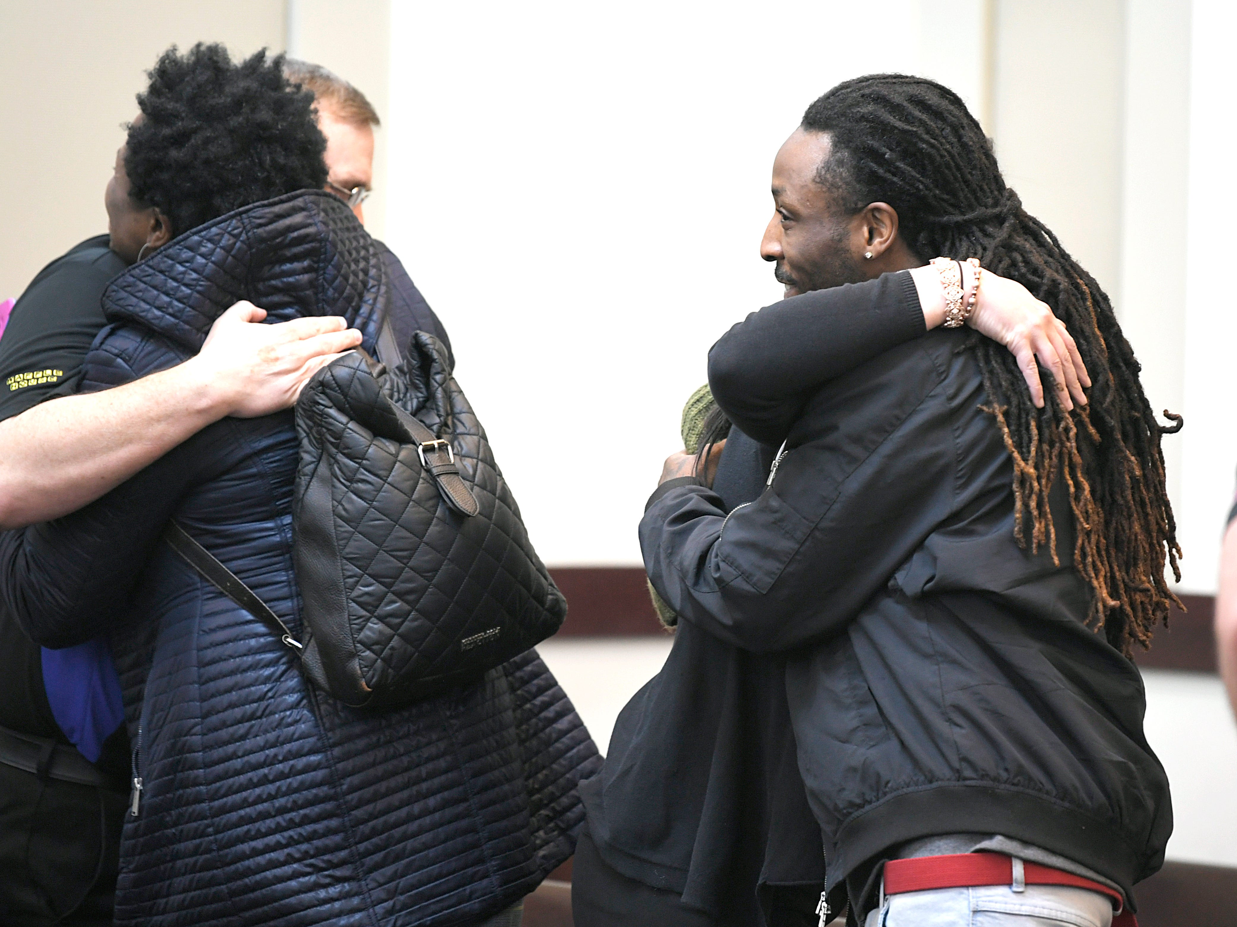 Waffle House employees hugs family members of Waffle House victims before a hearing on Waffle House shooting suspect Travis Reinking in Judge Mark Fishburn's courtroom in Nashville on Wednesday, Feb. 13, 2019.