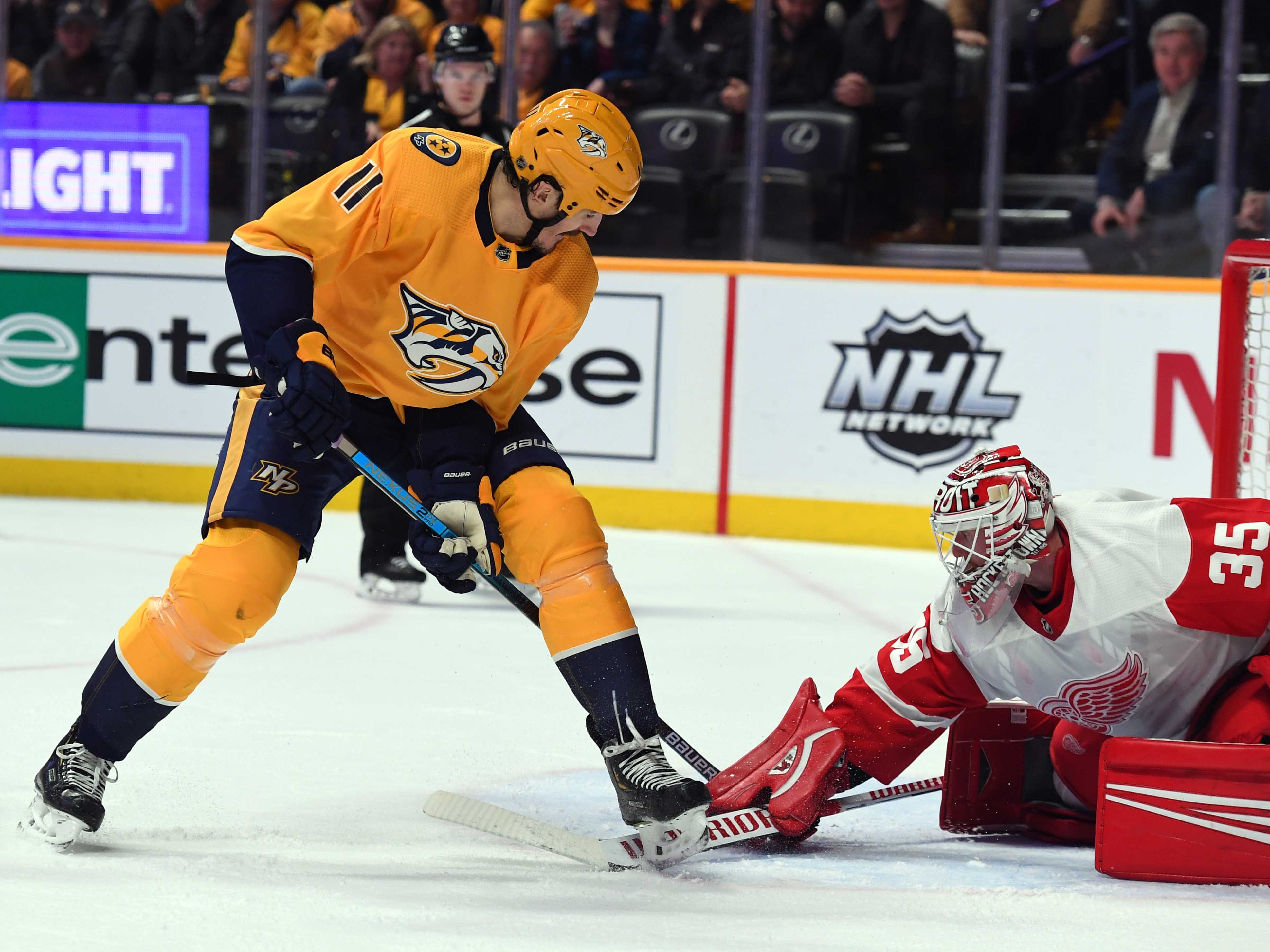 Predators center Brian Boyle (11) attempts a shot between his legs on Detroit Red Wings goaltender Jimmy Howard (35) during the first period at Bridgestone Arena.