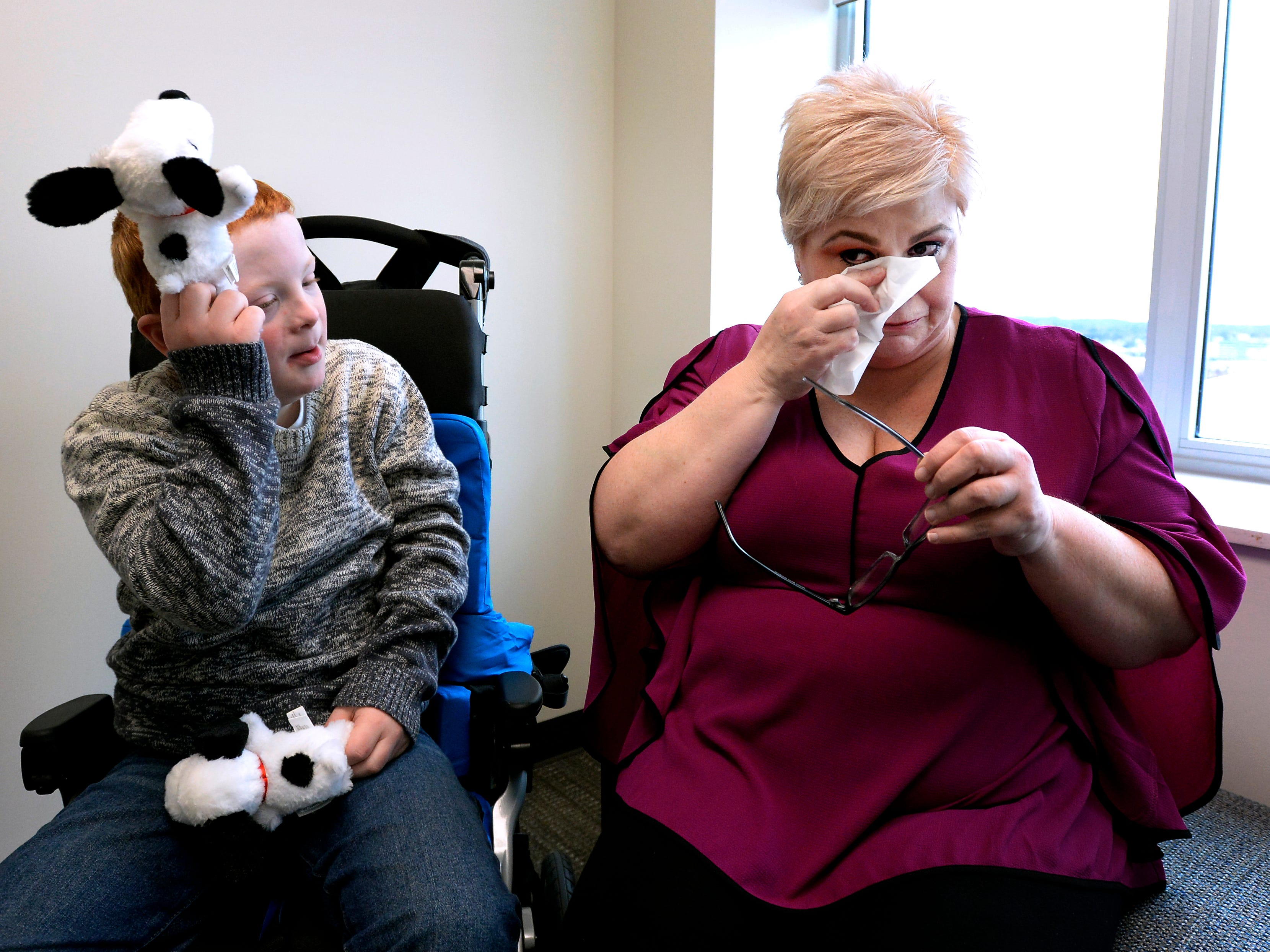 Single mother Jennifer Schultz cries as she talks about taking care of her son Hatcher Ryan, 10, who has Down Syndrome, as they wait to speak with Tennessee State senators during Disability Day on the Hill Tuesday, Feb. 12, 2019, in Nashville, Tenn. Families and advocates of people with disabilities in Tennessee met with lawmakers to express concerns and the needs of the disabled in the state.