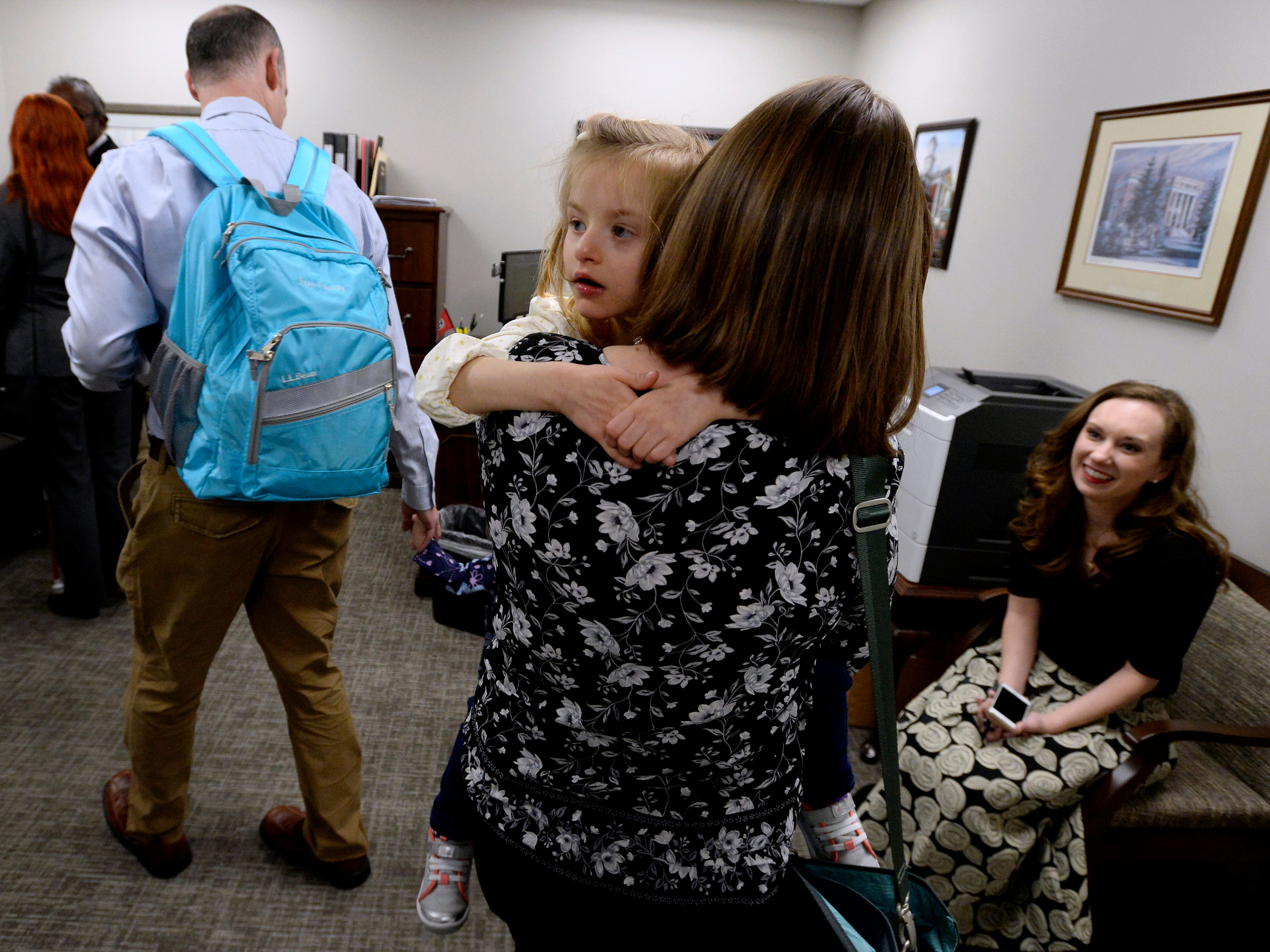 Jessica Fox, carries her daughter Clare, 4, as she follows her husband Sean into the office of Tennessee State Sen. Rusty Crowe, R-Johnson City, before talking with him during Disability Day on the Hill Tuesday, Feb. 12, 2019, in Nashville, Tenn. Families and advocates of people with disabilities in Tennessee met with lawmakers to express concerns and the needs of the disabled in the state.