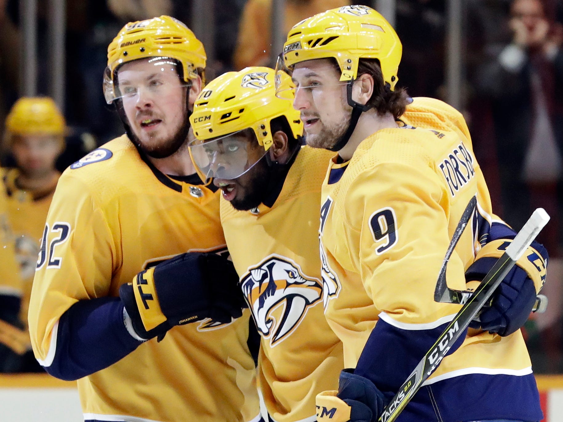 Feb. 12, 2019 -- Red Wings 3, Predators 2 -- Nashville Predators defenseman P.K. Subban, center, celebrates with Ryan Johansen (92) and Filip Forsberg (9), of Sweden, after Subban scored against the Detroit Red Wings during the second period of an NHL hockey game Tuesday, Feb. 12, 2019, in Nashville, Tenn.