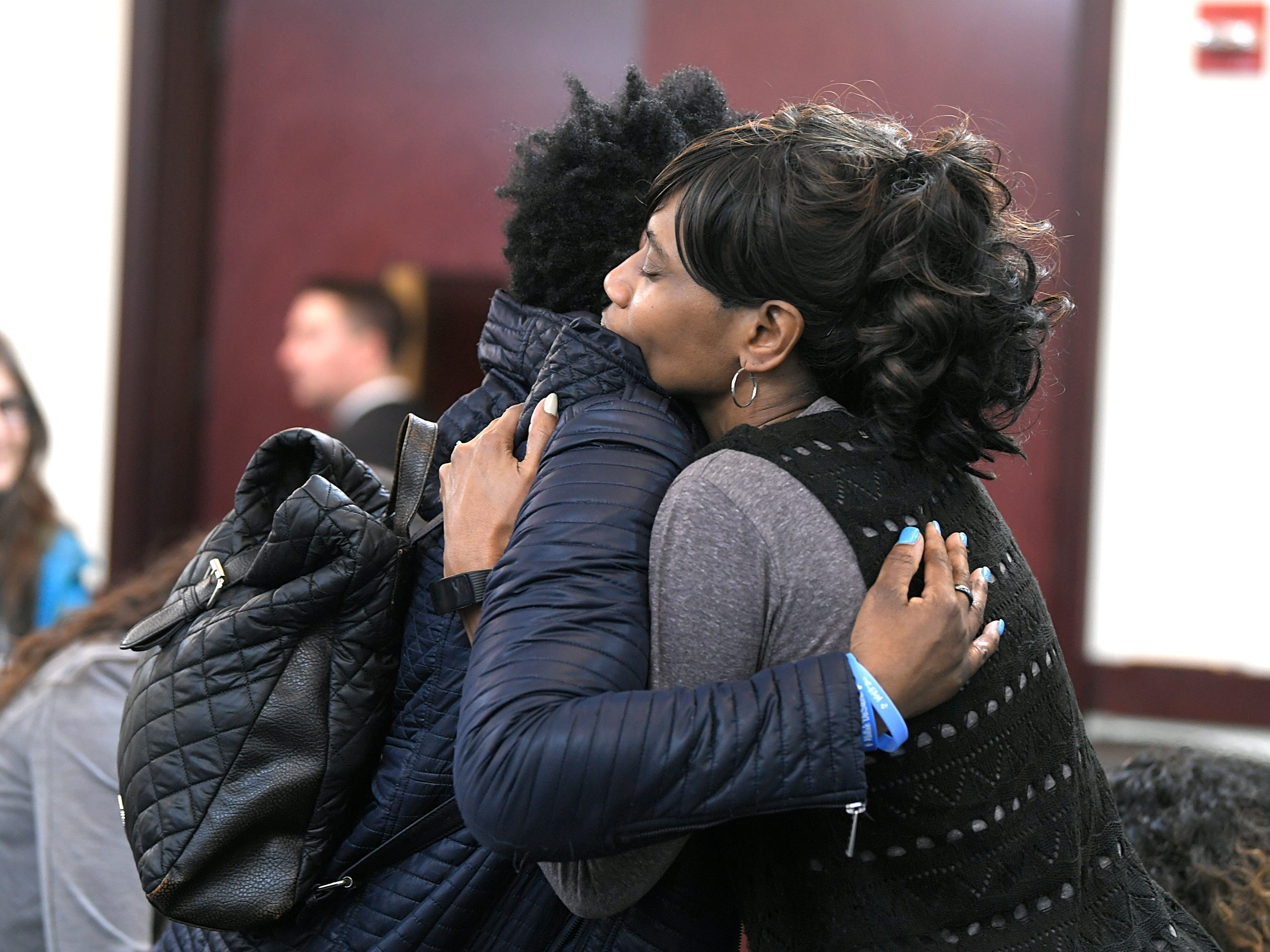 Shaundelle Brooks, mother of Akilah Dasilva, and Shirl Baker, DeEbony Groves' mom,  hug before a hearing on Waffle House shooting suspect Travis Reinking in Judge Mark Fishburn's courtroom in Nashville on Wednesday, Feb. 13, 2019.