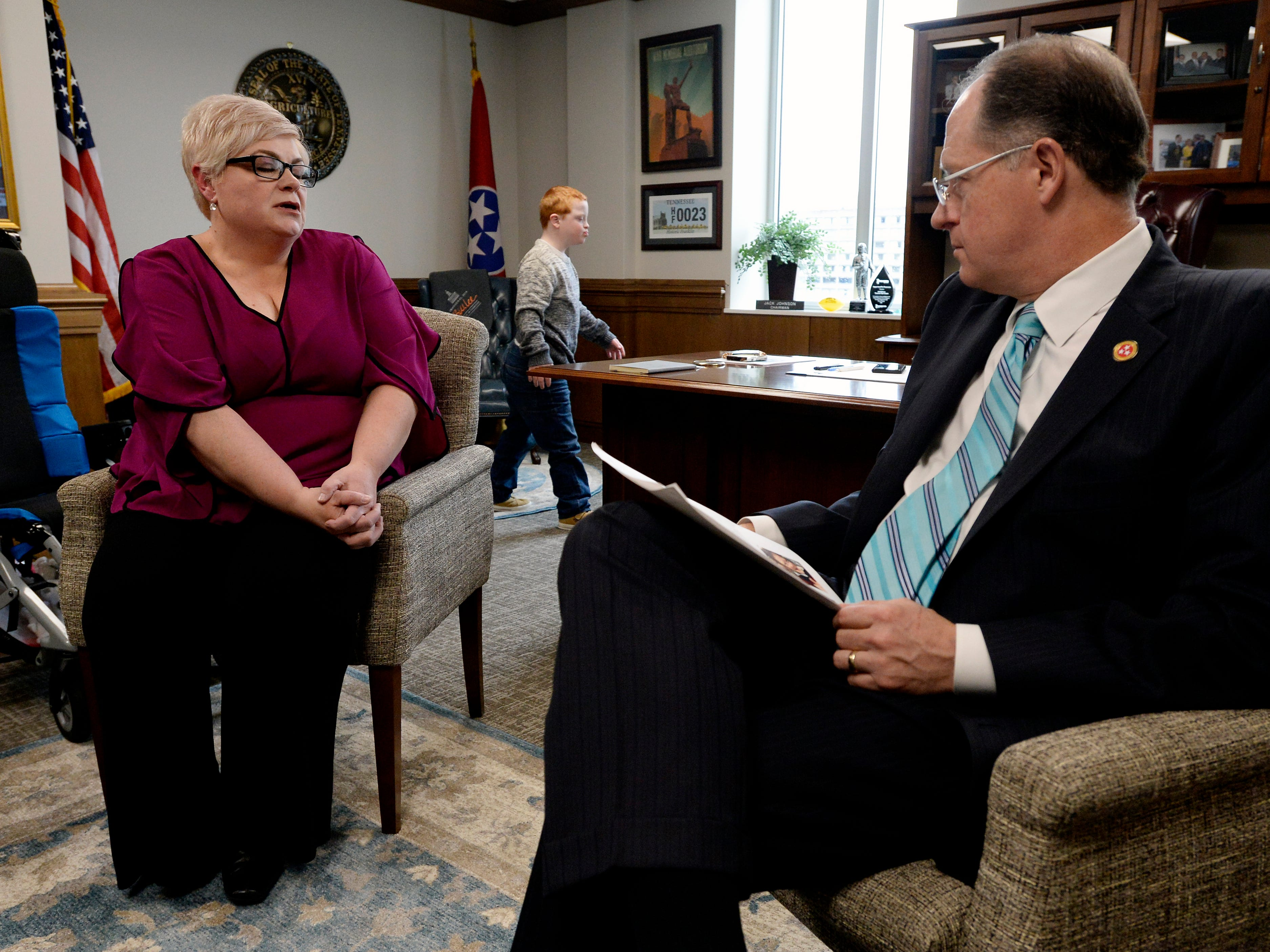 Single mother Jennifer Schultz talks with  Tennessee State Senate Majority Leader Jack Johnson as Hatcher Ryan Schultz, 10, who has Down syndrome, walks around his office during Disability Day on the Hill Tuesday, Feb. 12, 2019, in Nashville, Tenn. Families and advocates of people with disabilities in Tennessee met with lawmakers to express concerns and the needs of the disabled in the state.