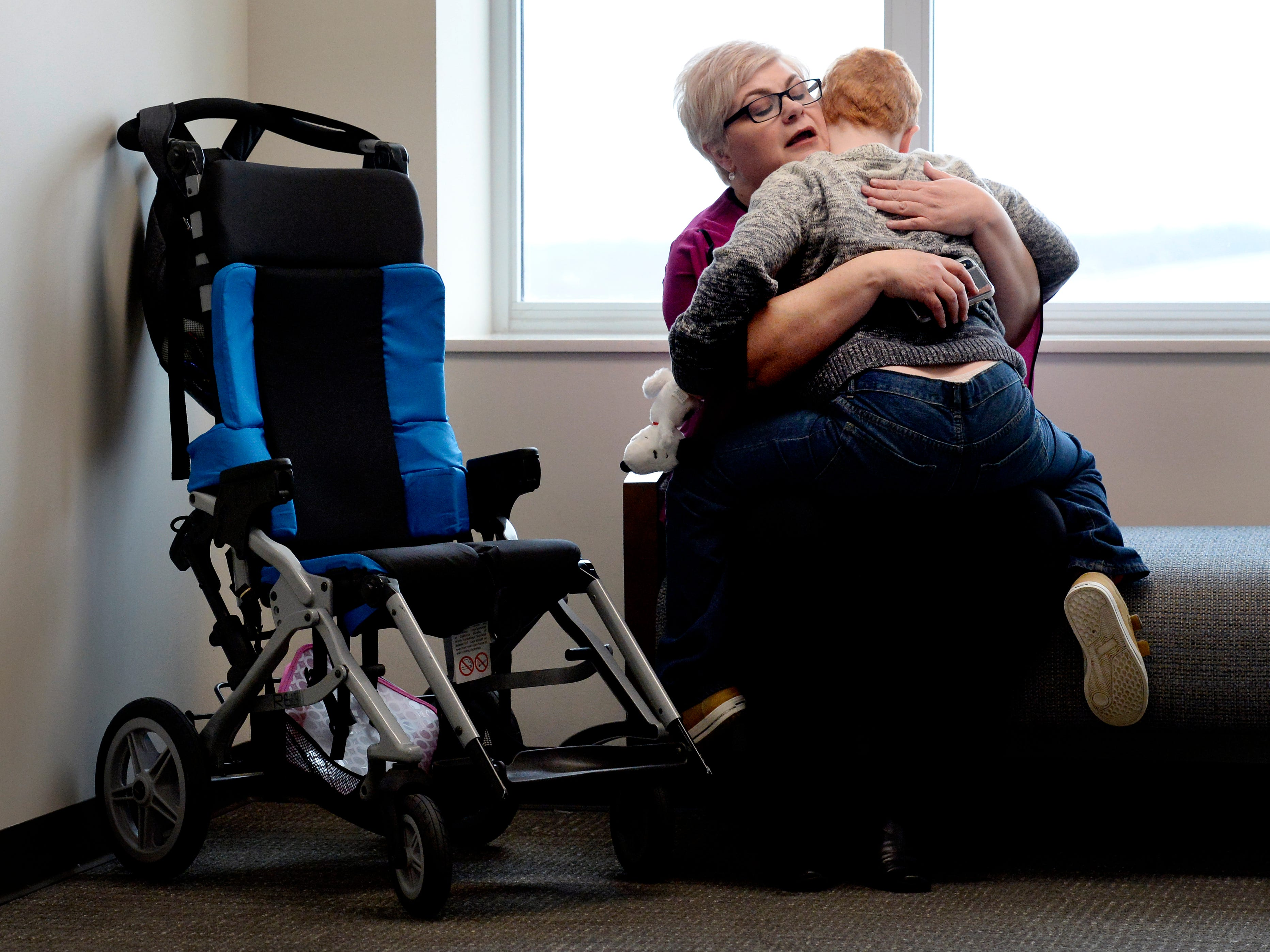 Jennifer Schultz holds onto her son, Hatcher Ryan, 10, who has Down syndrome, as they wait to talk with senators during Disability Day on the Hill on Tuesday, Feb. 12, 2019, in Nashville. Schultz graduated from college in December and wants to work, but she worries that her son might lose services if she makes too much money.