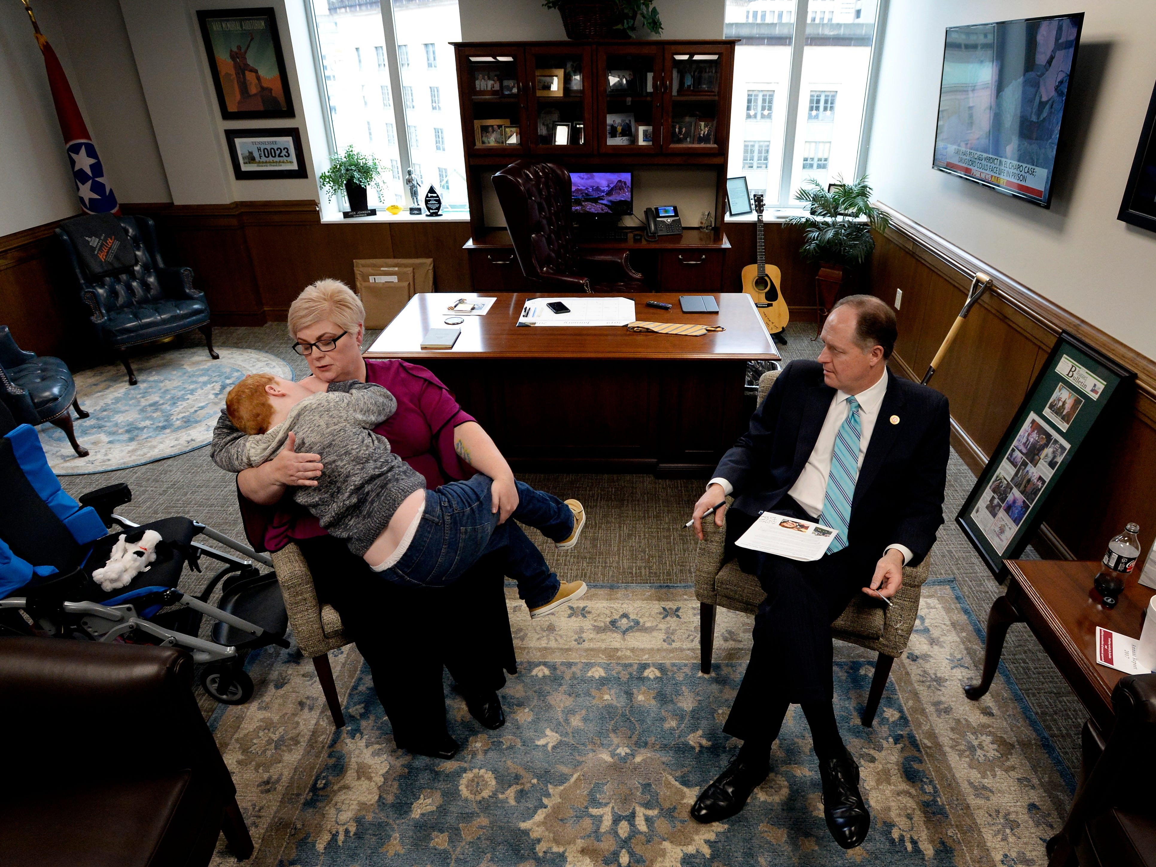Jennifer Schultz comforts her son, Hatcher Ryan, 10, as she talks with Senate Majority Leader Jack Johnson, R-Franklin, during Disability Day on the Hill on Tuesday, Feb. 12, 2019, in Nashville.