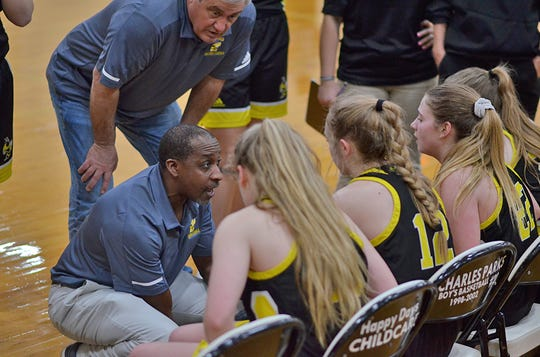 Fairview Lady Jackets Coach Wayne McGowan talks strategy with the team during District Tournament Feb. 11, 2019.