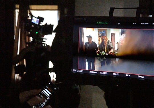 Hollywood star Charlie Sheen is seen on a monitor as he is directing and starring in a music video for independent country-rock artist Tim Montana Tuesday, Feb. 12, 2019, in Watertown, Tenn.
