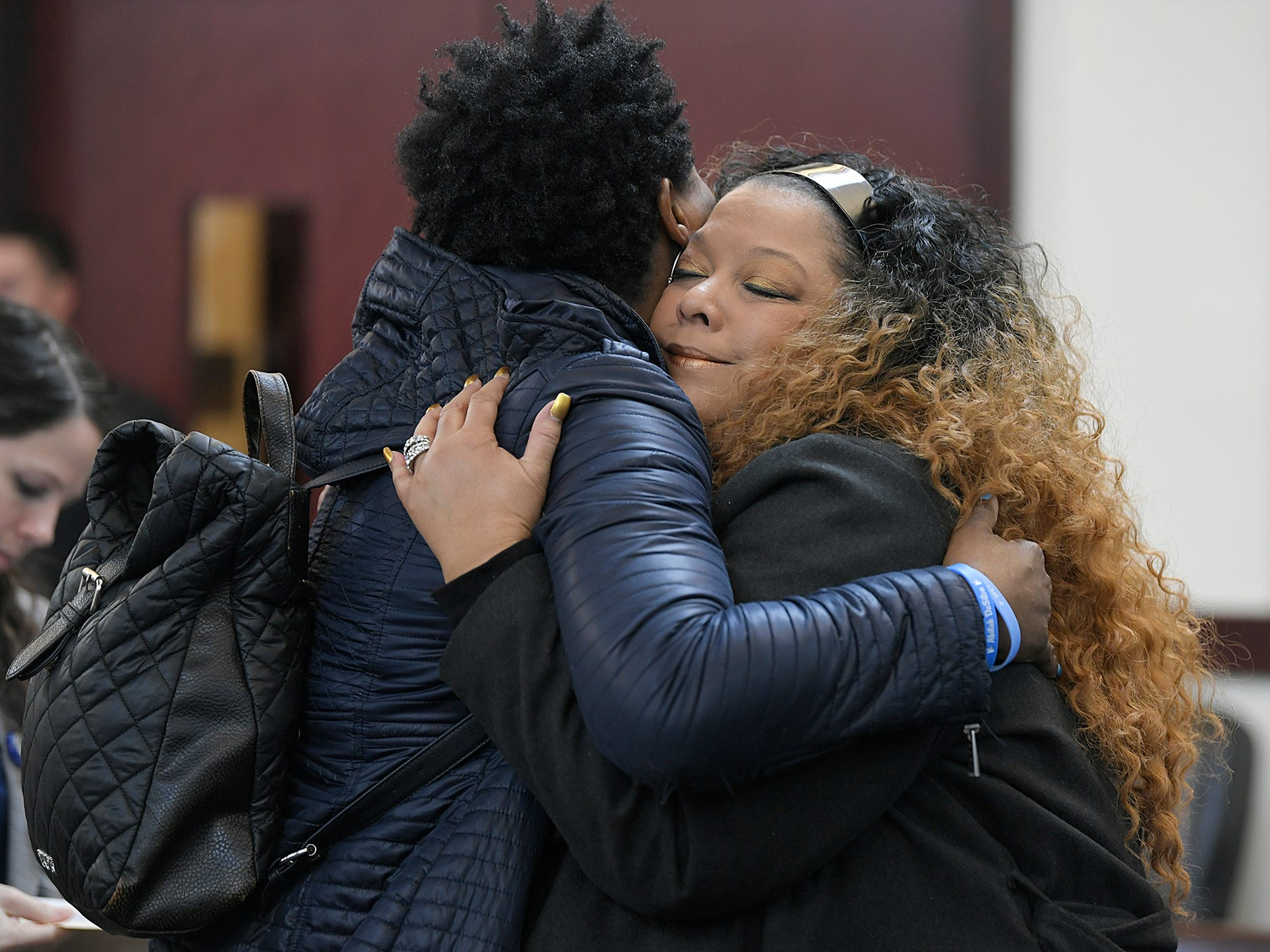 Family members and friends of Waffle House victims embrace each other before a hearing for shooting suspect Travis Reinking. His public defender Jon Wing entered a not guilty plea during a hearing in Judge Mark Fishburn's courtroom in Nashville on Wednesday, Feb. 13, 2019.  Reinking faces 17 charges related to the mass shooting that killed four people at a Waffle House in 2018.
