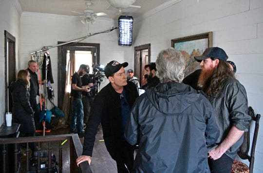 Hollywood star Charlie Sheen, talks with independent country-rock artist Tim Montana, right, who he is making a music video with Tuesday, Feb. 12, 2019, in Watertown, Tenn.