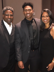 Vanderbilt freshman pitcher, center, with father Tracy Rocker, the Tennessee Vols defensive line coach, and mother Lu Rocker.