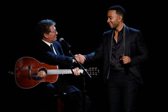 "Mac Davis, left, and John Legend perform during NBC's ""Elvis All-Star Tribute."""