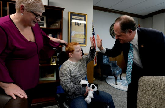 Hatcher Ryan, 10, who has down syndrome, high fives Tennessee State Senate Majority Leader Jack Johnson, R-Franklin, after his mother Jennifer Schultz spoke with him in his office during Disability Day on the Hill Tuesday, Feb. 12, 2019, in Nashville, Tenn. Families and advocates of people with disabilities in Tennessee met with lawmakers to express concerns and the needs of the disabled in the state.