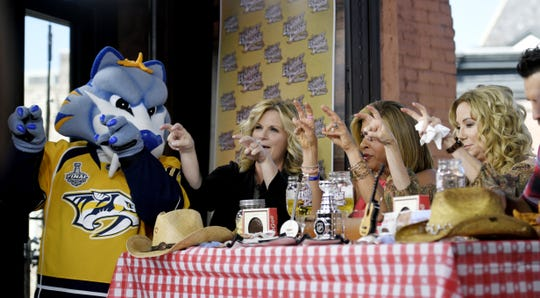 Nashville Predators mascot Gnash, left, Trisha Yearwood and Today Show hosts Kathie Lee & Hoda tape an show at Honky Tonk Central on June 7, 2017.
