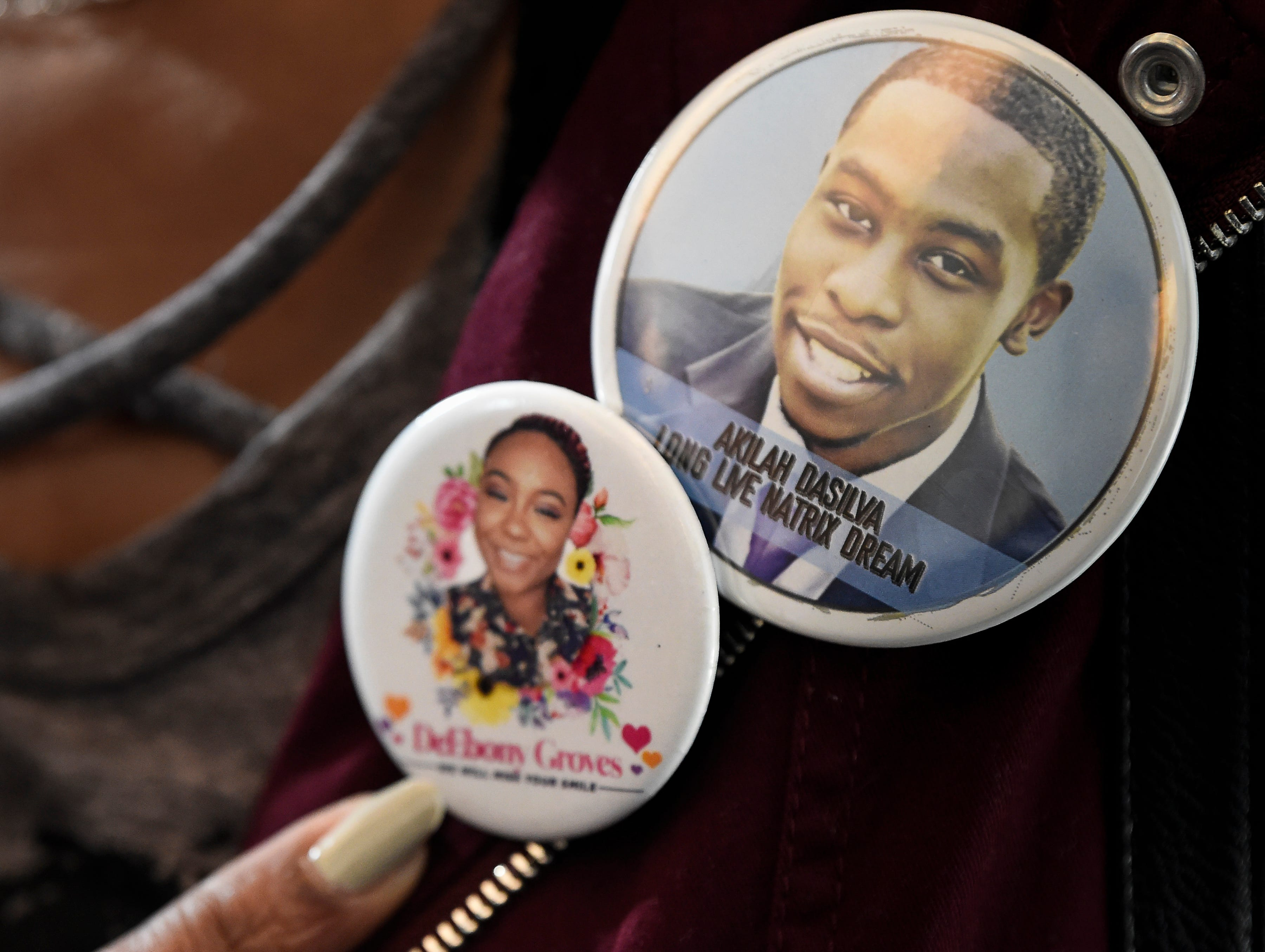 Shirl Baker wears buttons on her label honoring her daughter DeEbony Groves and fellow Waffle House victim Akilah Dasilva after Travis Reinking pleaded not guilty to charges related to a mass shooting that killed four people and injured several others at a Waffle House last year during his arraignment hearing at Justice A. A. Birch Building Wednesday, Feb. 13, 2019 in Nashville, Tenn.