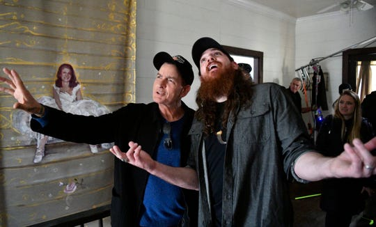 Hollywood star Charlie Sheen hams it up for the camera as he shoots a music video with independent country-rock artist Tim Montana Tuesday, Feb. 12, 2019, in Watertown, Tenn.