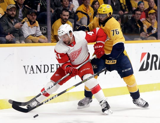 Detroit Red Wings center Luke Glendening (41) is defended by Nashville Predators' P.K. Subban (76) during the first period of an NHL hockey game Tuesday, Feb. 12, 2019, in Nashville, Tenn.