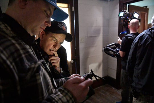 Hollywood star Charlie Sheen looks over a take on set as he is directing and starring in a music video for independent country-rock artist Tim Montana Tuesday, Feb. 12, 2019, in Watertown, Tenn.