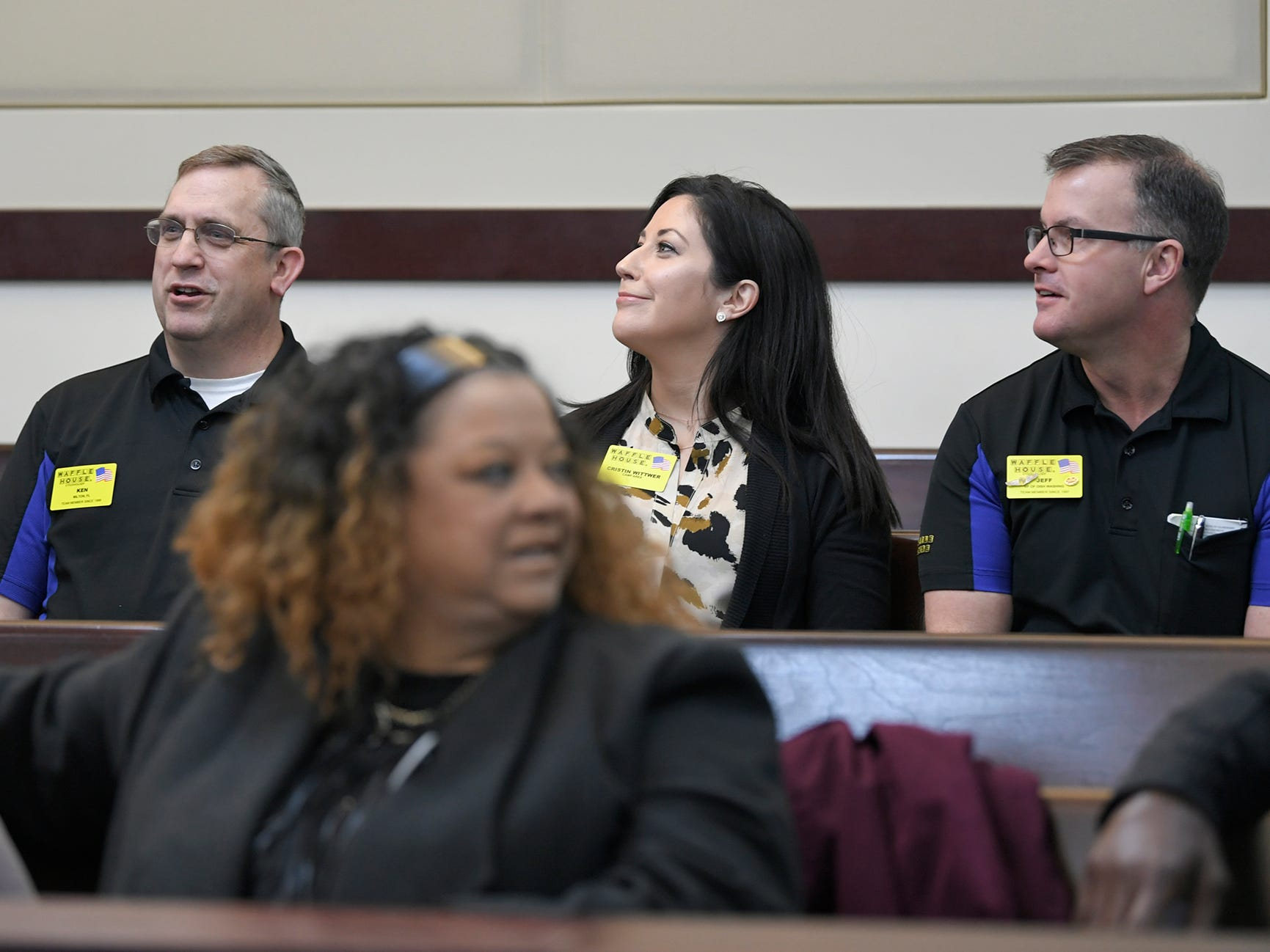 Three Waffle House employees talk with family members of Waffle House victims before a hearing on Waffle House shooting suspect Travis Reinking in Judge Mark Fishburn's courtroom in Nashville on Wednesday, Feb. 13, 2019.
