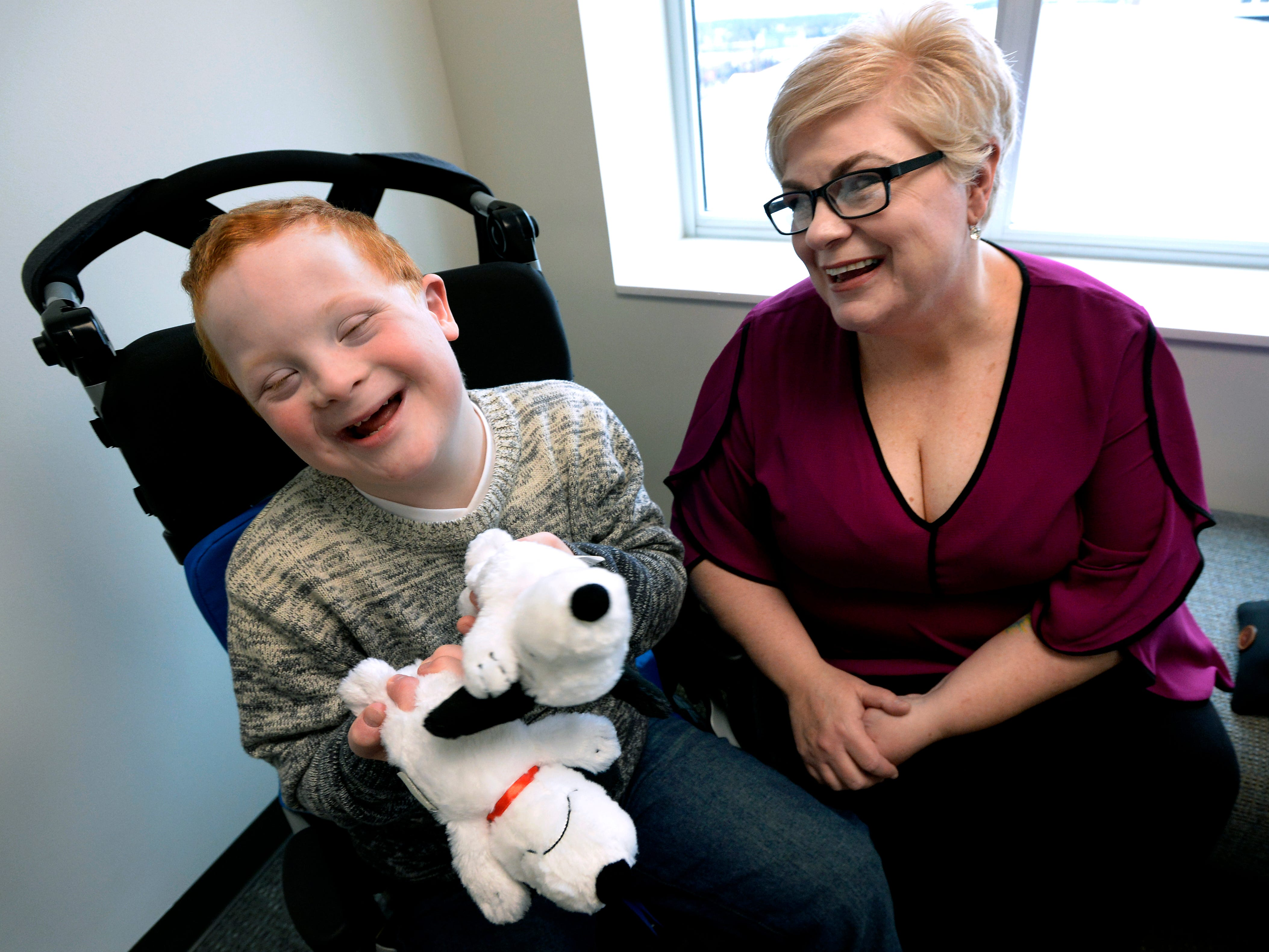 Single mother Jennifer Schultz laughs with her son Hatcher Ryan, 10, who has Down Syndrome, as they wait to talk with Tennessee State senators during Disability Day on the Hill Tuesday, Feb. 12, 2019, in Nashville, Tenn. Families and advocates of people with disabilities in Tennessee met with lawmakers to express concerns and the needs of the disabled in the state.