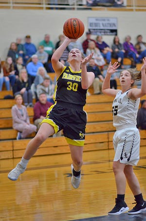 Fairview sophomore Kelsey Gossage drives in for the basket at District Tournament Feb. 11, 2019.