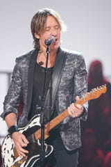 "Keith Urban plays the guitar and sings at the ""Elvis All-Star Tribute"" on NBC."