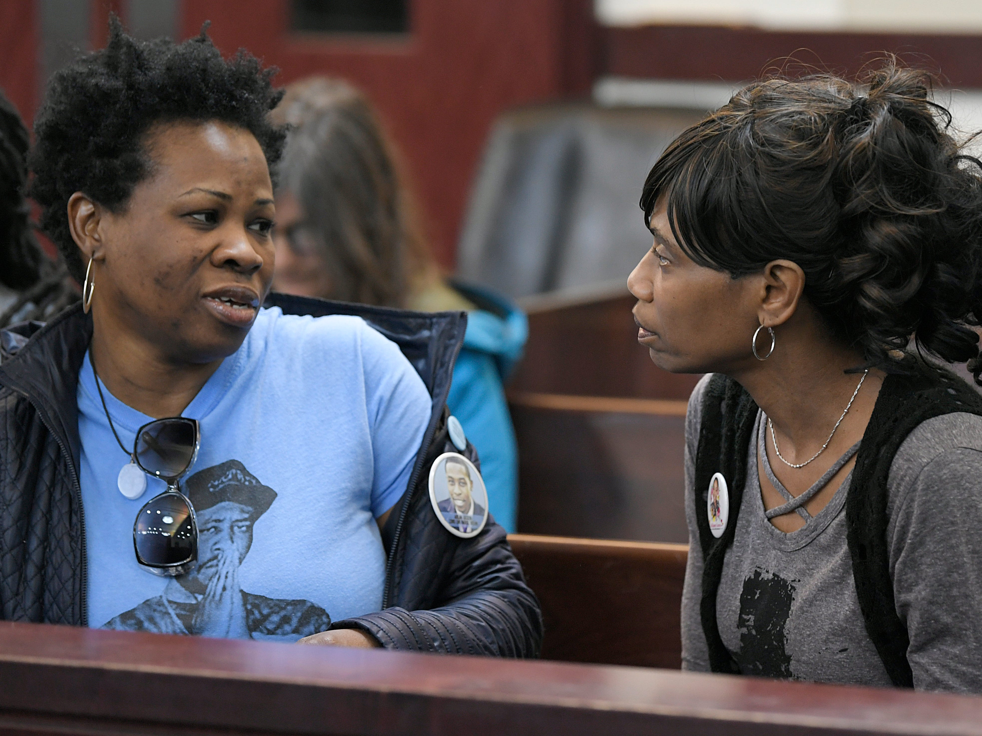 Shaundelle Brooks, mother of Akilah Dasilva, and Shirl Baker, DeEbony Groves' mom, talk before a hearing on Waffle House shooting suspect Travis Reinking in Judge Mark Fishburn's courtroom in Nashville on Wednesday, Feb. 13, 2019.