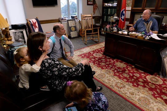 Claire Fox, 4, left, hides behind her mother Jessica as her husband Sean speaks with Tennessee State Senator Rusty Crowe, R-Johnson City, during Disability Day on the Hill Tuesday, Feb. 12, 2019, in Nashville, Tenn. Families and advocates of people with disabilities in Tennessee met with lawmakers to express concerns and the needs of the disabled in the state.