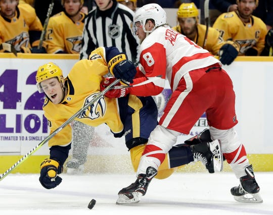 Detroit Red Wings left wing Justin Abdelkader, right, checks Nashville Predators center Kyle Turris off the puck during the second period of an NHL hockey game Tuesday, Feb. 12, 2019, in Nashville, Tenn.