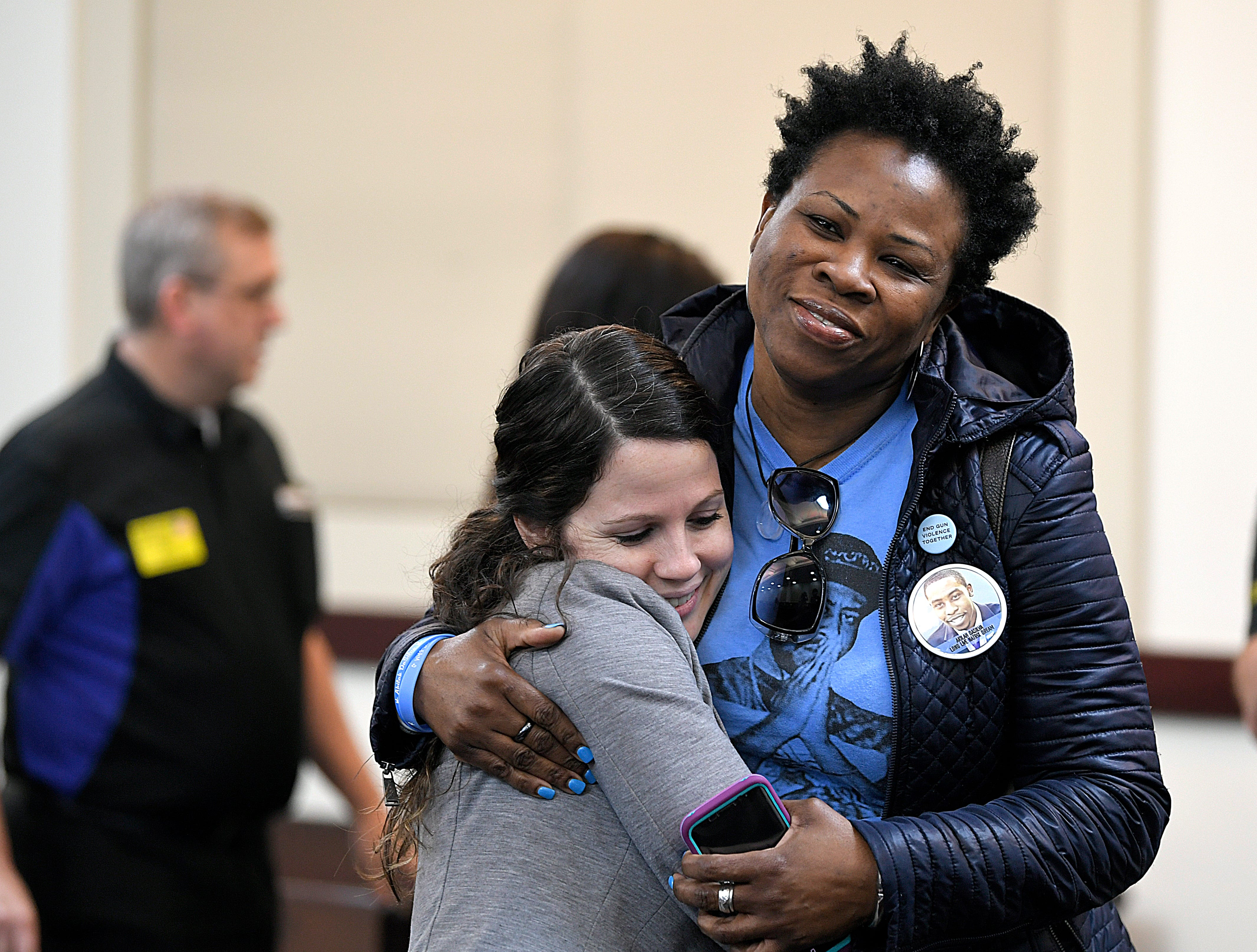 Shaundelle Brooks, mother of Waffle House victim Akilah Dasilva, hugs supporters before Waffle House shooting suspect Travis Reinking's hearing on Wednesday, Feb. 13, 2019.