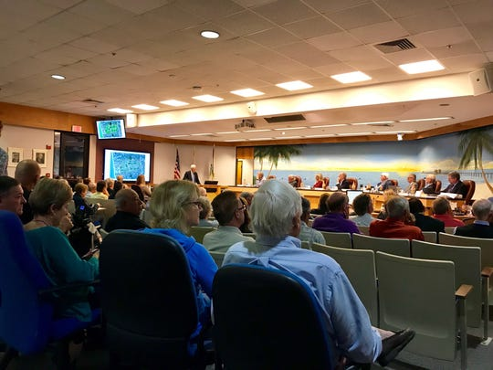 The Naples planning board considers the Naples Beach Hotel's redevelopment proposal on Feb. 13, 2019. The meeting room was so packed that city staff had to bring in additional chairs.