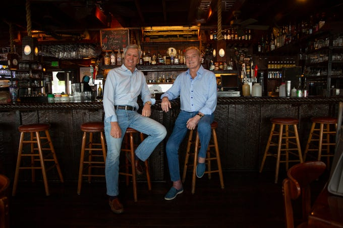 Doug Traina, left, and Vin Depasquale pose for a portrait, Wednesday, Feb. 13, 2019, at The Dock restaurant in Naples. Vin Depasquale recently sold The Dock restaurant to Doug Traina, founder, president and C.E.O. of T.E.I. Industries.
