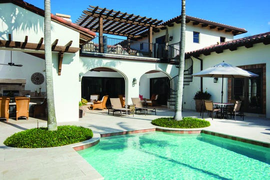 The renovation included an addition of a portico, a new pool bath cabana and an expansion of the outdoor kitchen.