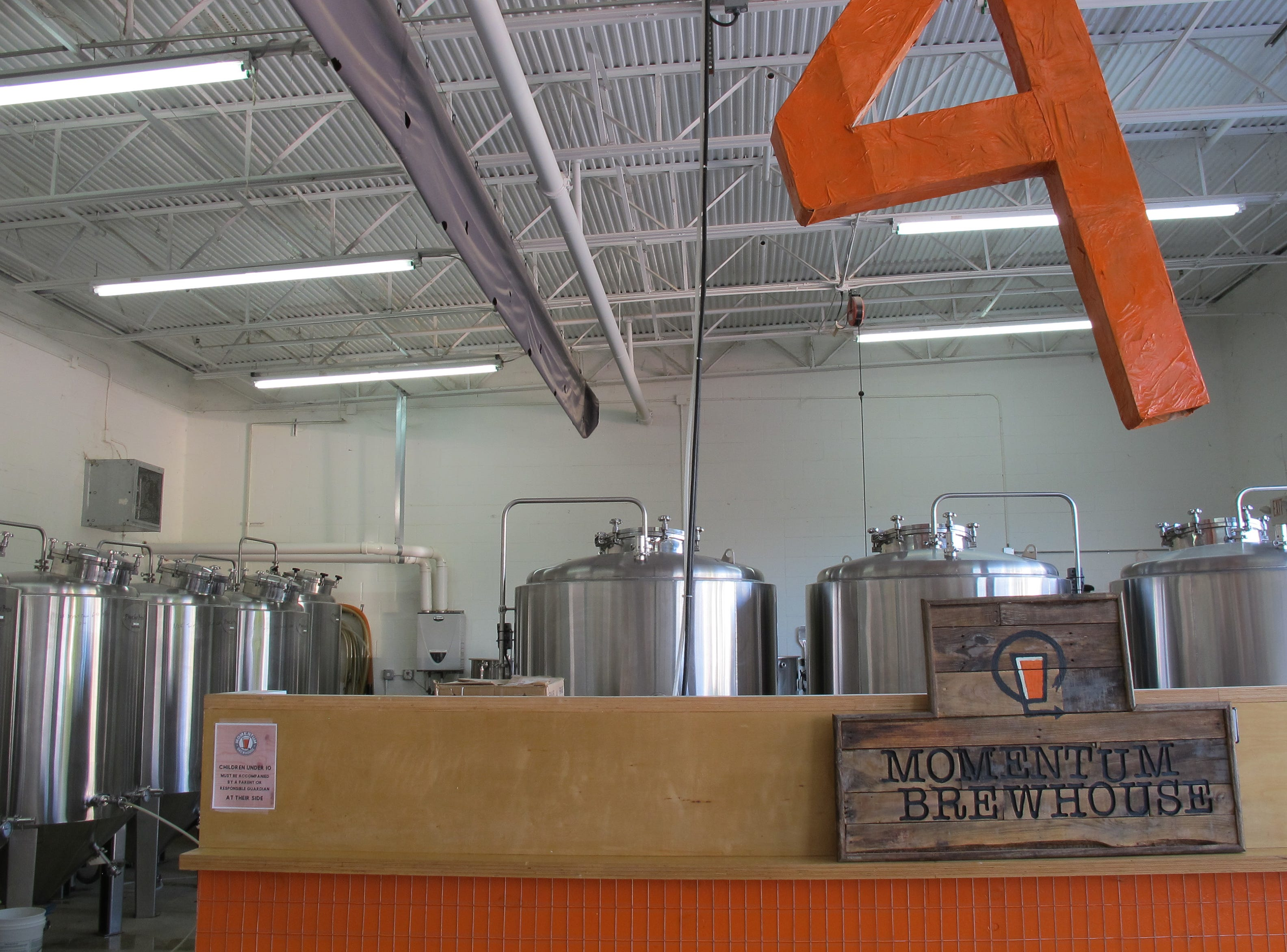 Four-year-old Momentum Brewhouse in Bonita Springs has a five-barrel system for brewing craft beers.