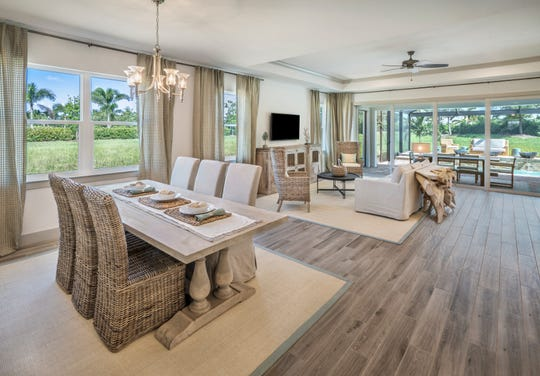 Dining/living room in Estes model at Naples Reserve.