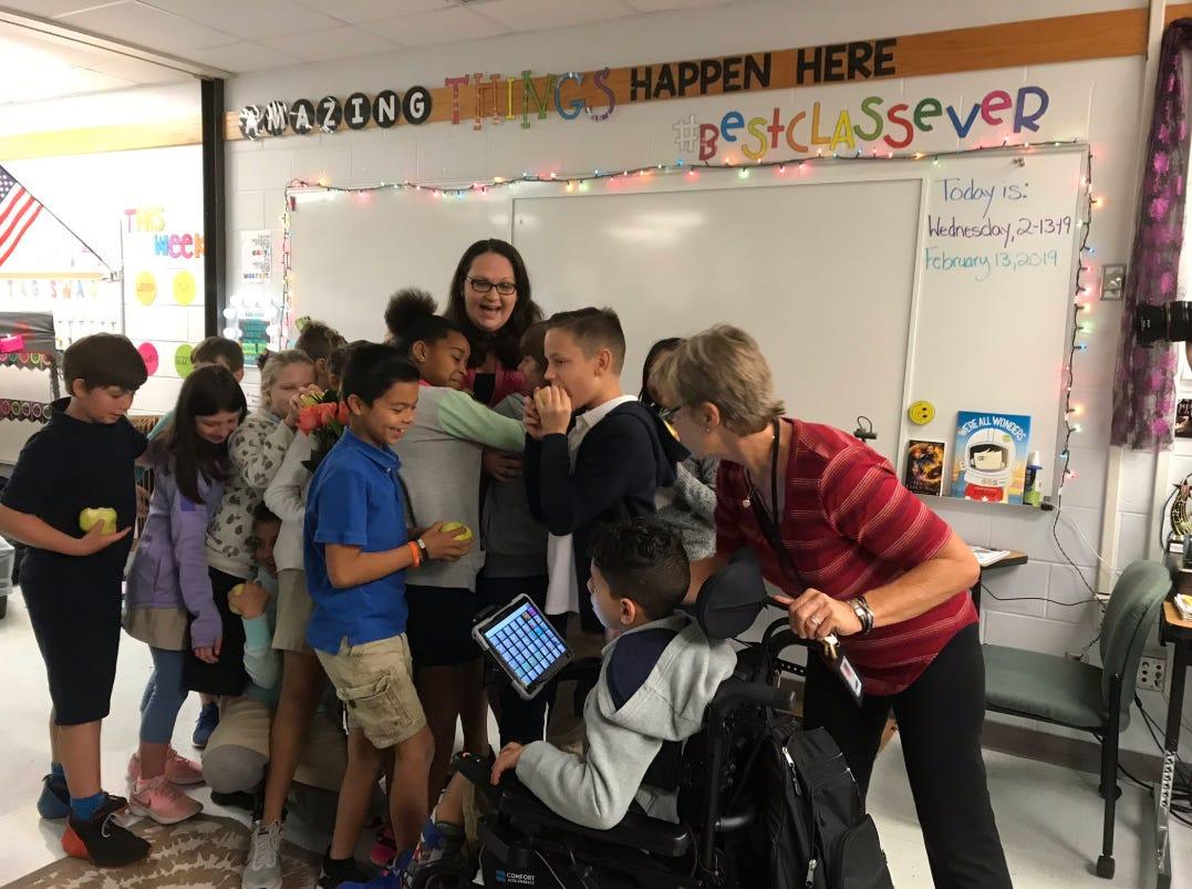 Krista Fusco, a 4th grade teacher at Vineyards Elementary, receives the first Golden Apple award on Wednesday, Feb. 13, 2019.