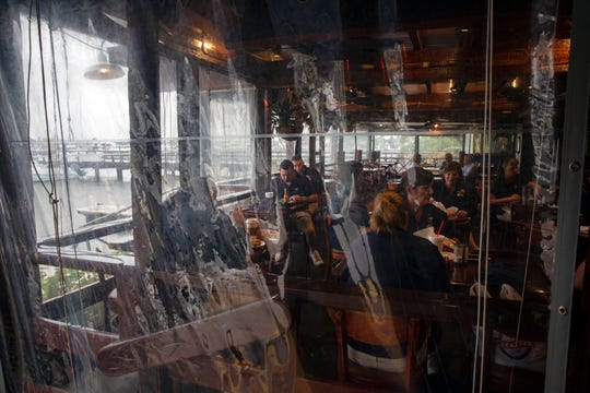 Restaurant staff members gather for lunch before the start of the workday, Wednesday, Feb. 13, 2019, at The Dock restaurant in Naples.