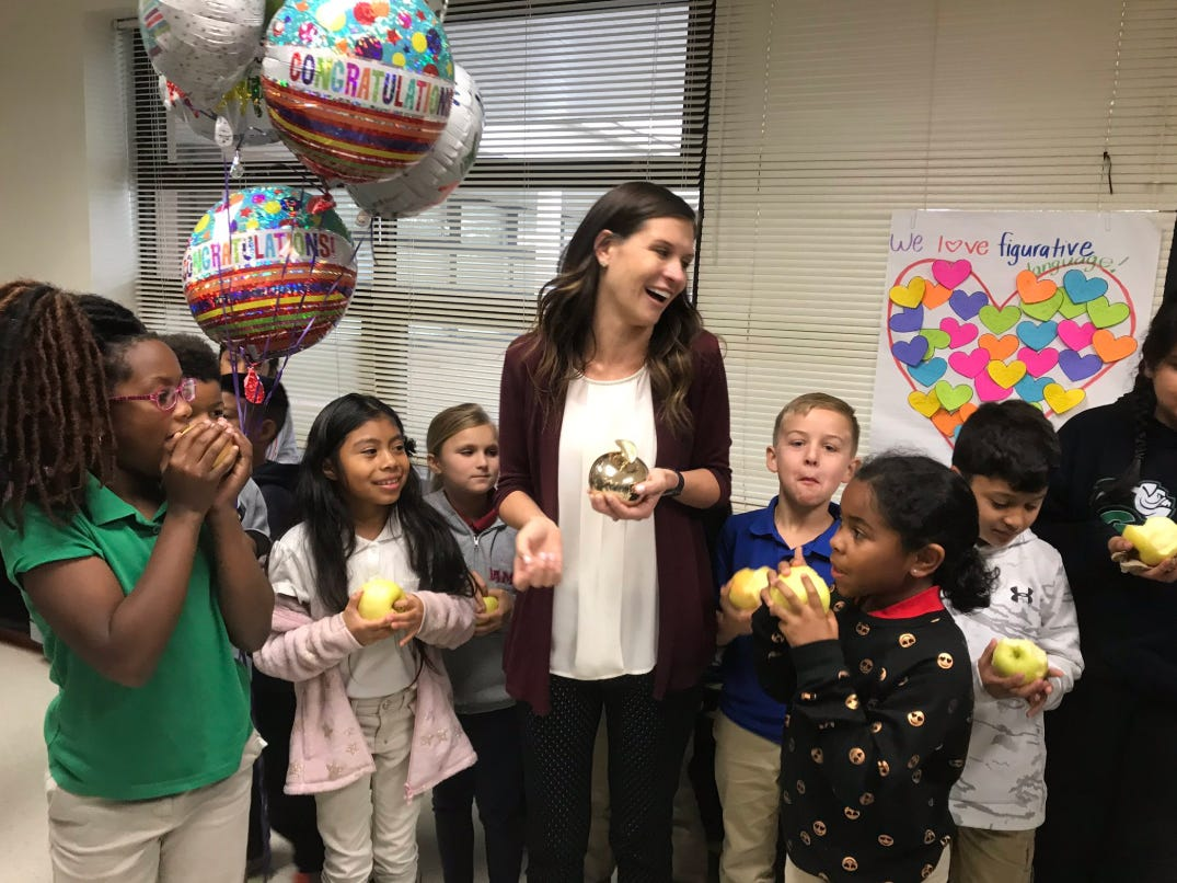 """Jill Striz, a third grade teacher at Village Oaks Elementary in Immokalee, receives her Golden Apple award Wednesday, Feb. 13, 2019. Striz, 25, said she sets goals for her class high and once the students reach them they go beyond. """"Whenever you set high expectations they're always going to exceed those expectations,"""" she said."""